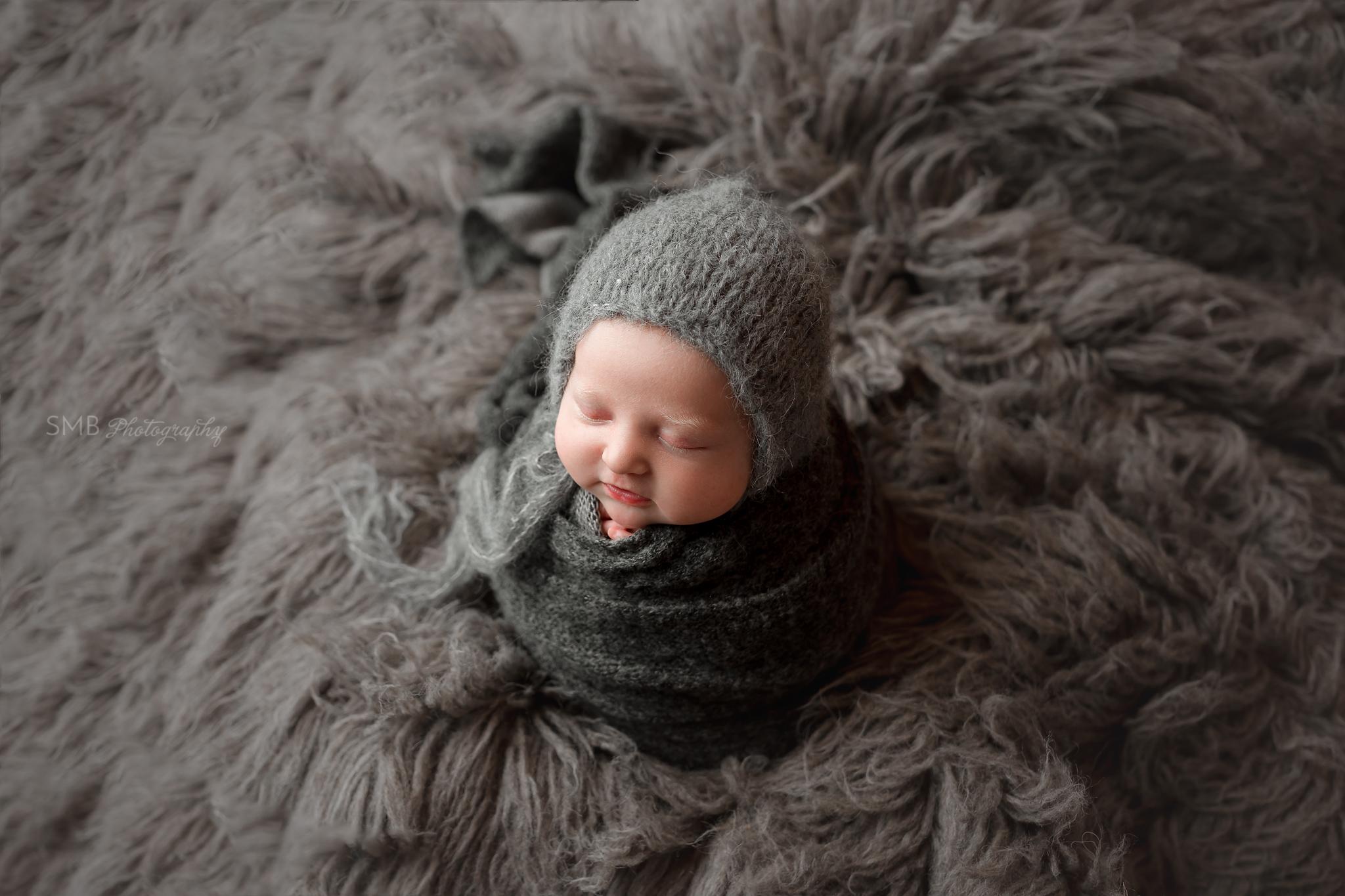 Newborn baby girl smiling