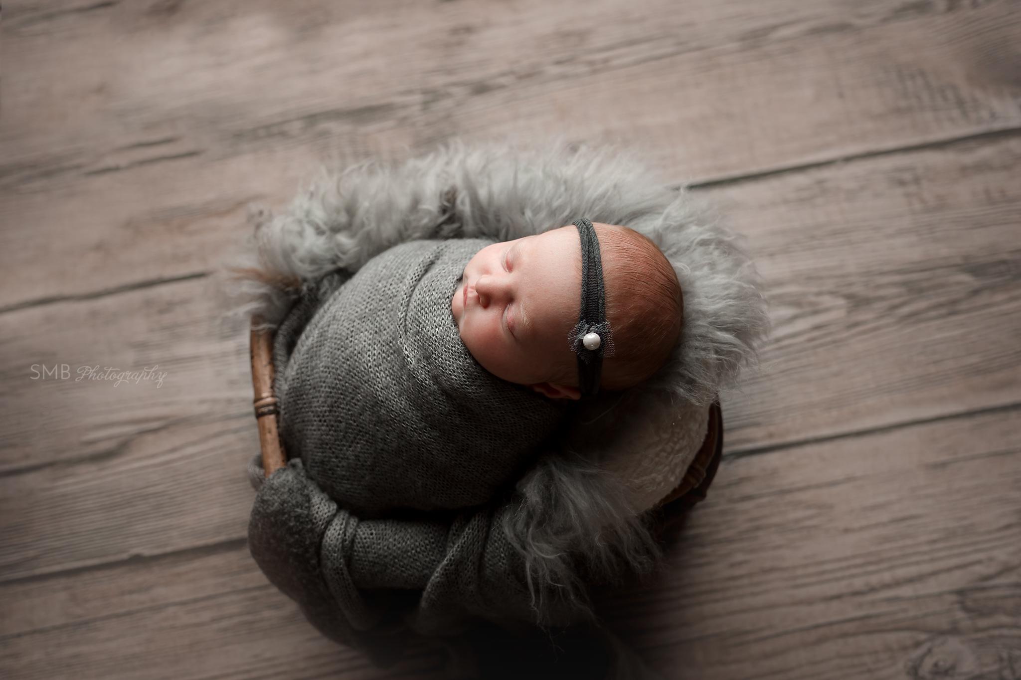 Baby girl wearing charcoal headband