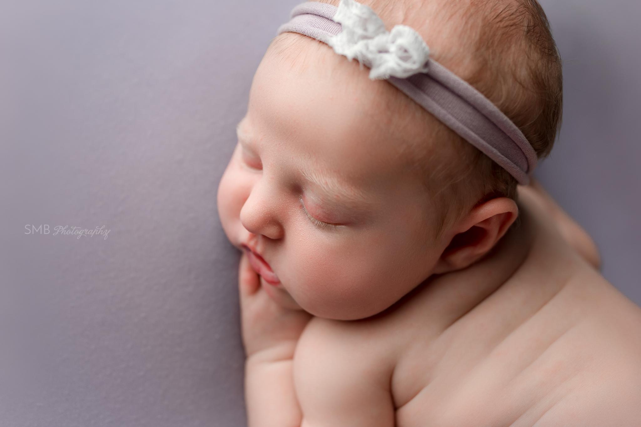 Profile image of newborn face