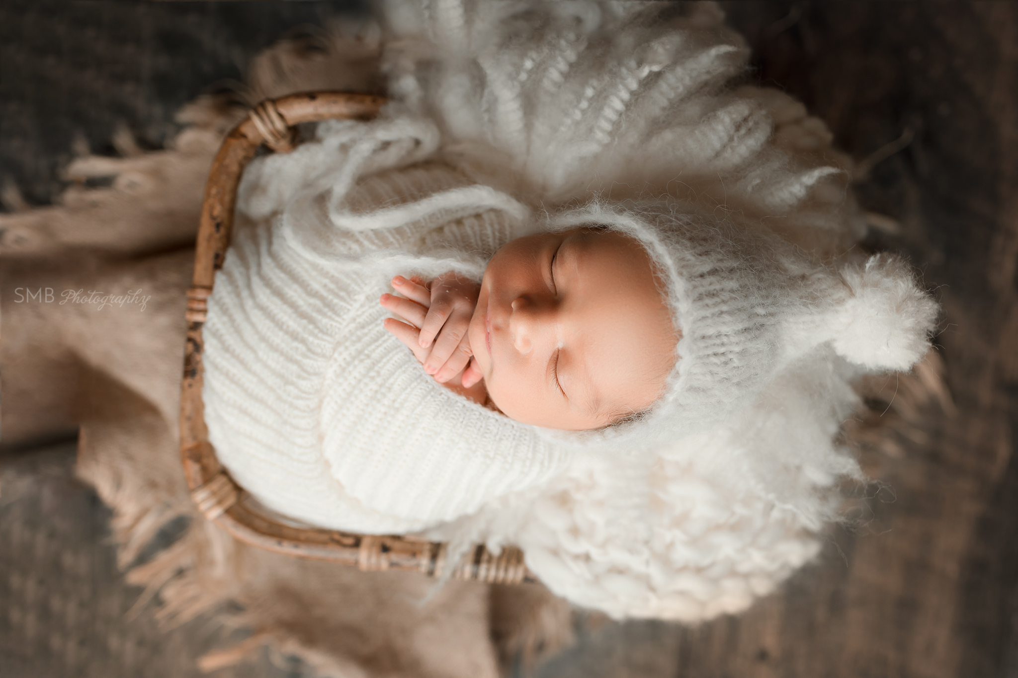 Closeup of newborn in basket