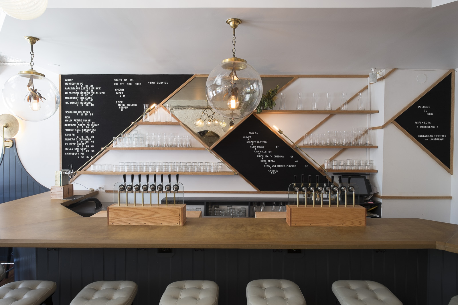 back bar with custom white oak shelves and integrated brass lighting