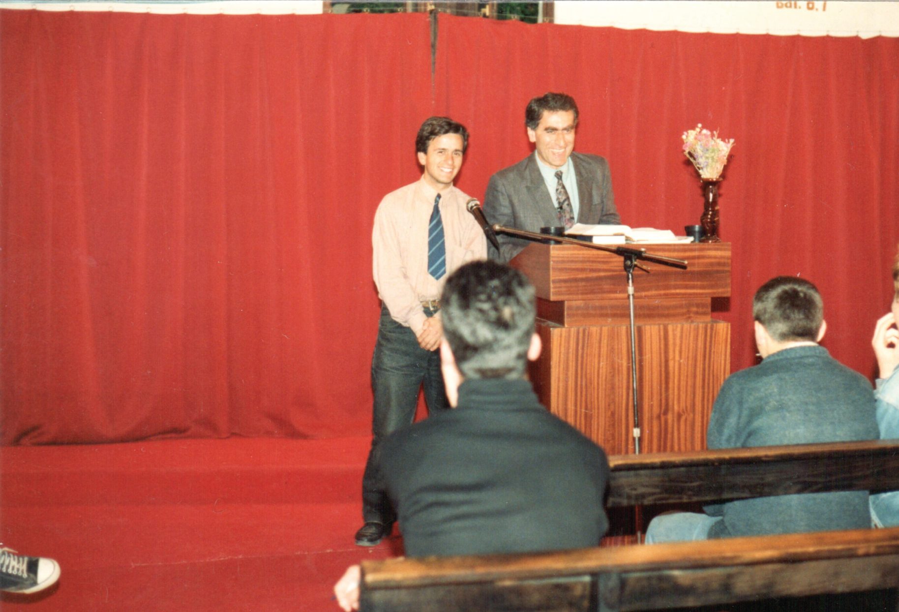 Georges preaching at an evangelistic revival
