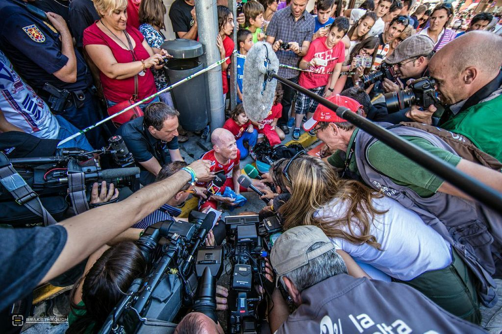 Chris Horner is surrounded by journalists after the penultimate stage of the 2013 Vuelta a Espana.