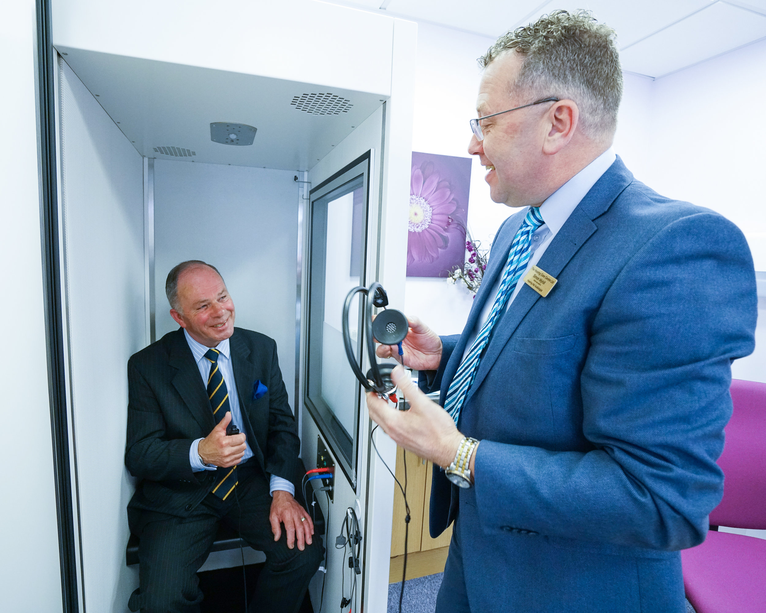 Audiologist Simon Myhill conducting a hearing assessment.jpg