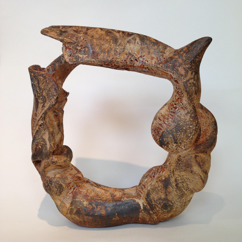 Caro Burberry 'circle of life' cast iron.JPG