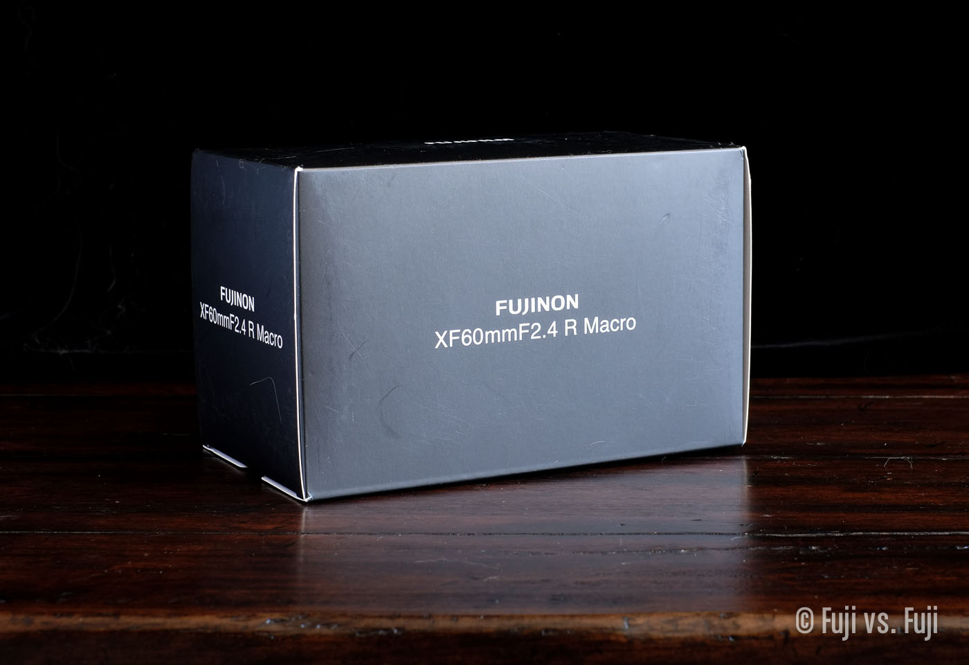 TheFUJINON XF 60mm f/2.4 Macro old-style box design enclosure