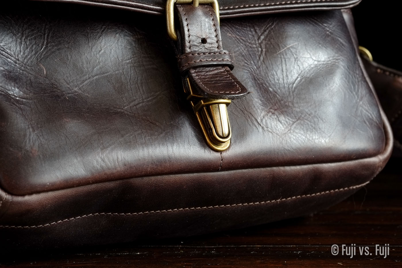 Single adjustable clasp hidden by a flap of leather
