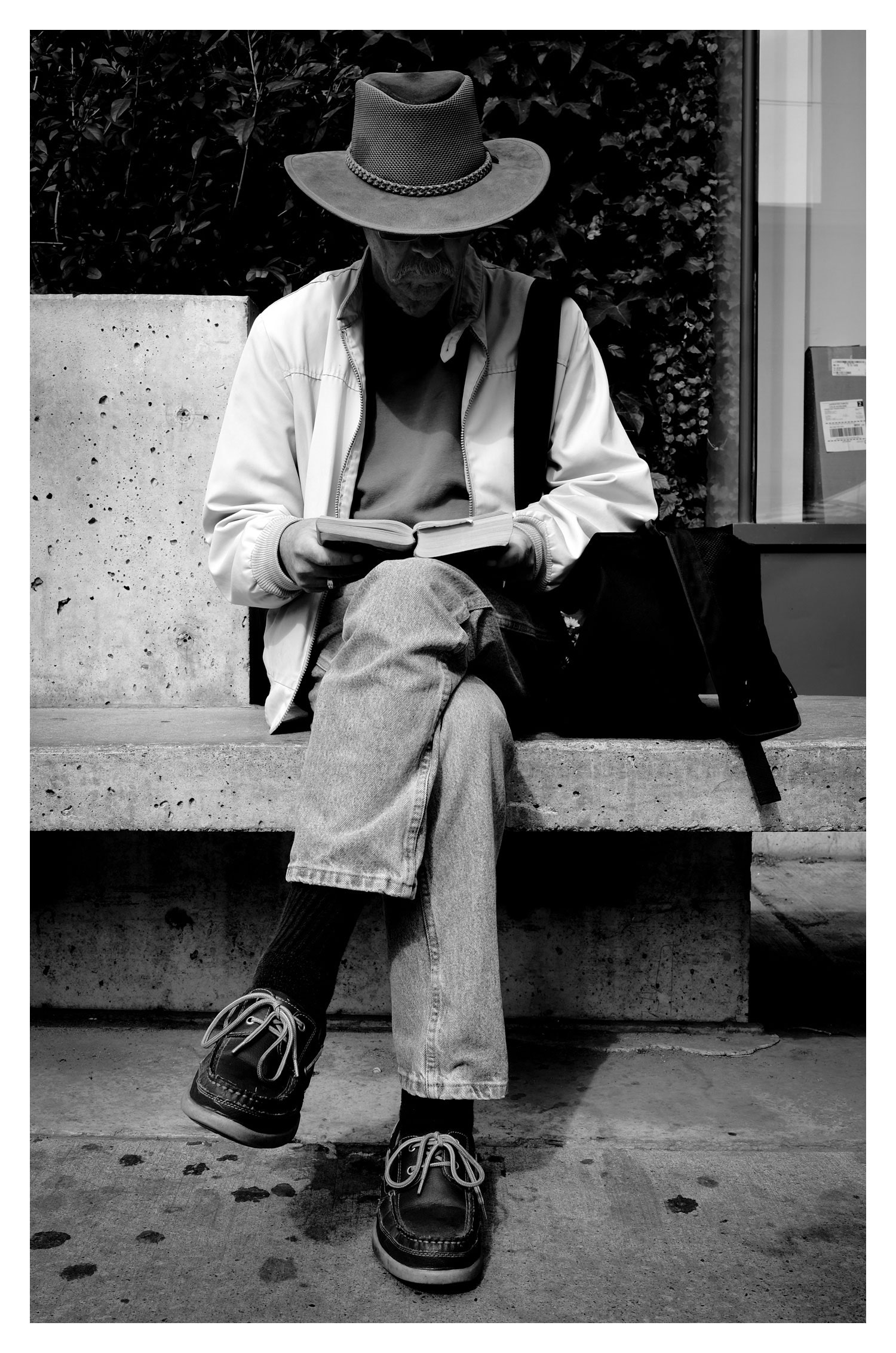 I stood next to this gentleman with my camera held casually at my side, and snapped this shot with the Remote App