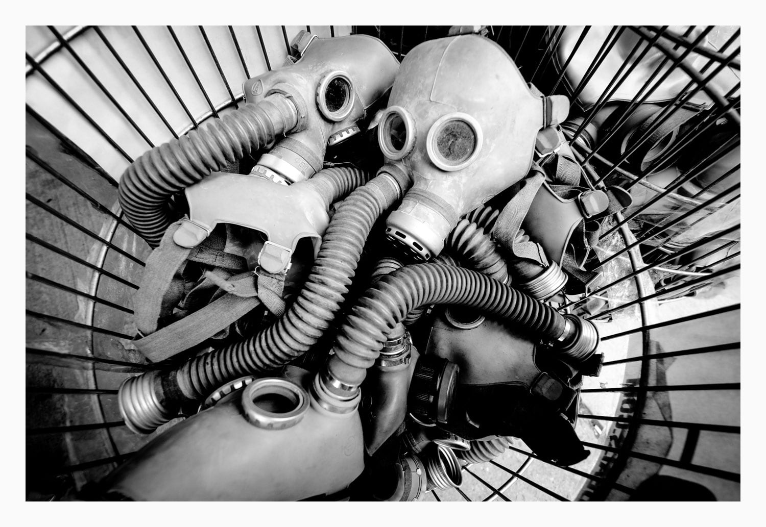 Jam an ultra-wide angle lens ina wire basket full of gas masks and you're sure to get an interesting image