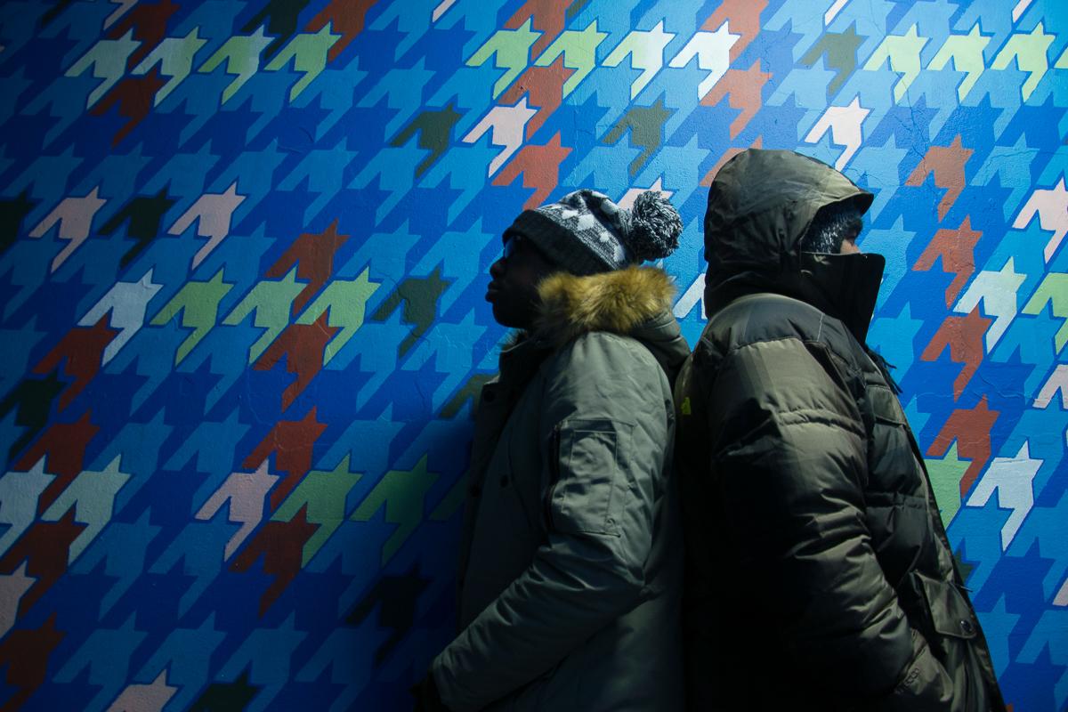 My homie John and I posing next to street art