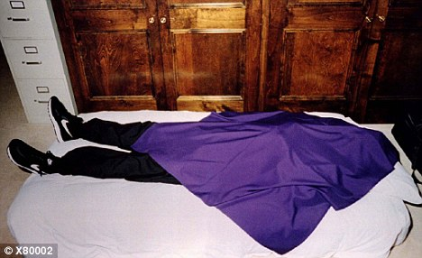 A cult member after the suicide, seen wearing  the cult signature cortez and the purple cloth.