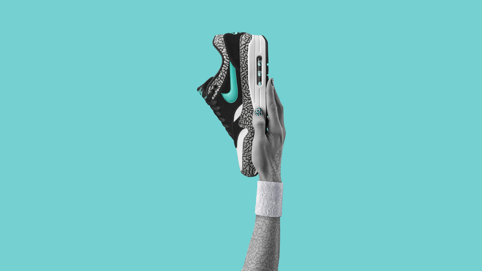 """The Air Max 1 atmos was the undisputed winner of the Air Max Day 2016 Vote Back campaign. The collaboration spliced a staple Nike motif with meticulous color blocking to highlight the subtle jade Swoosh. Co-created by famed Japanese retailer, Atmos, this sneaker was originally part of the """"Zoo Pack,"""" released in 2006."""