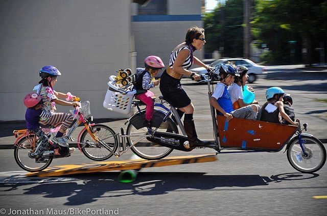 "Haute Wheels Racing wishes a joyful Mother's Day to all the moms out there! You inspire us and make the world go 'round. 💖 photo from https://bikeportland.org/2012/06/28/with-six-kids-and-no-car-this-mom-does-it-all-by-bike-73731/amp (""Emily [Finch] bikes for a simple and somewhat corny reason. It makes her happy. And she and Mitch love the sweet chaos of children and family. 'I love my bike,' she insisted repeatedly during our conversation, 'I really do. Because it's changed my life. I can't really explain it. In the end, my bike just brings me happiness.'"")"