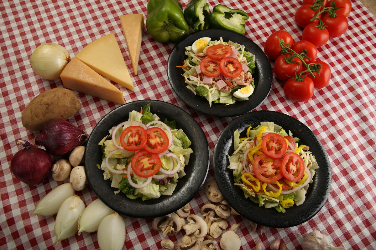Salads - Italian SaladCrisp Iceberg and Romaine Lettuce Blend, Pepperoni, Provolone Cheese, Red Onion, Hot Peppers, Bacon & Roma TomatoesSmall: $5.49 | Large: $7.99Chef SaladCrisp Iceberg and Romaine Lettuce Blend, Provolone Cheese, Bacon, Eggs & Roma Tomatoes. Your choice of Ham or ChickenSmall: $5.99 | Large: $7.99Chicken Caesar SaladCrisp romaine lettuce, Parmesan/Romano cheese and chicken served with a side of Caesar dressingSmall: $4.49 | Large: $6.99Garden SaladCrisp Iceberg and Romaine Lettuce Blend, Provolone Cheese, Roma Tomatoes & Red OnionsSmall: $3.49 | Large: $4.99Marzetti Dressings: House Italian, Honey French, Ranch, Blue Cheese, Honey Mustard, Lite Italian, Fat-Free Ranch, Balsamic Vinaigrette, Caesar, 1000 Island