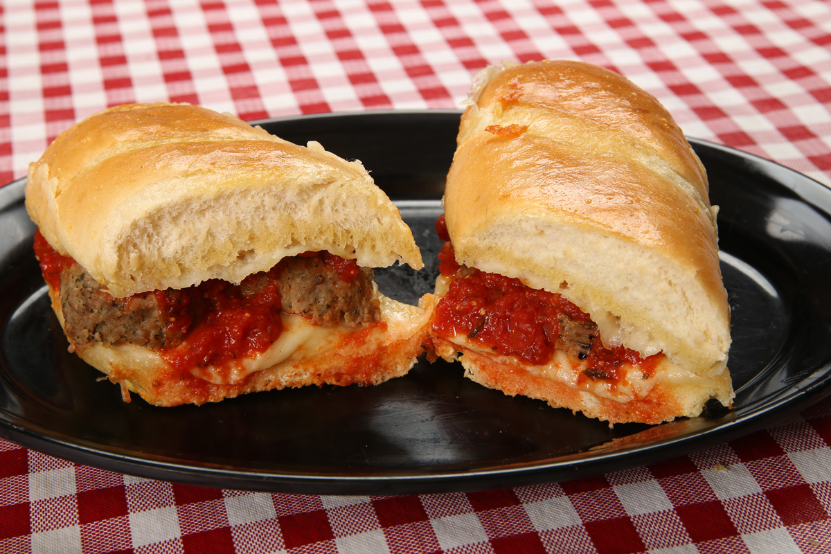 Hot Subs - Pizza Sub . . . . . . . . . . . . $7.49Pepperoni, Provolone Cheese & Pizza Sauce. Available served open-facedP.L.T Sub (Signature Dish). . . . . $7.49Crispy Pepperoni, Provolone Cheese, Lettuce, Roma Tomatoes & MayonnaiseMeatball Sub . . . . . . . . . $7.49Topped with garlic Butter, Provolone Cheese, Italian Meatballs & our Signature SauceItalian Sub. . . . . . . . . . . $7.49Deli sliced Ham, Salami, Jumbo Pepperoni, Provolone Cheese, Lettuce, Roma Tomatoes, Hot Peppers & Italian DressingHam & Cheese Sub. . . . . . . $7.49Deli sliced Ham, Provolone Cheese, Lettuce, Roma Tomatoes & MayonnaiseRuthie's Way Steak Sub (Signature Dish). . . . . $7.49Tender Steak loaded with Provolone Cheese, Grilled Onions, Mushrooms, Lettuce, Roma Tomatoes & MayonnaiseVeggie Sub. . . . . . . . . . . $7.49Mushrooms, Green Peppers & Onions topped with Provolone Cheese, Lettuce, Roma Tomatoes, Hot Peppers & Italian DressingCheddar Steak Sub. . . . . . $7.49Tender Steak loaded with our Cheddar Cheese Blend, Grilled Onions, Lettuce & 1000 Island Dressing