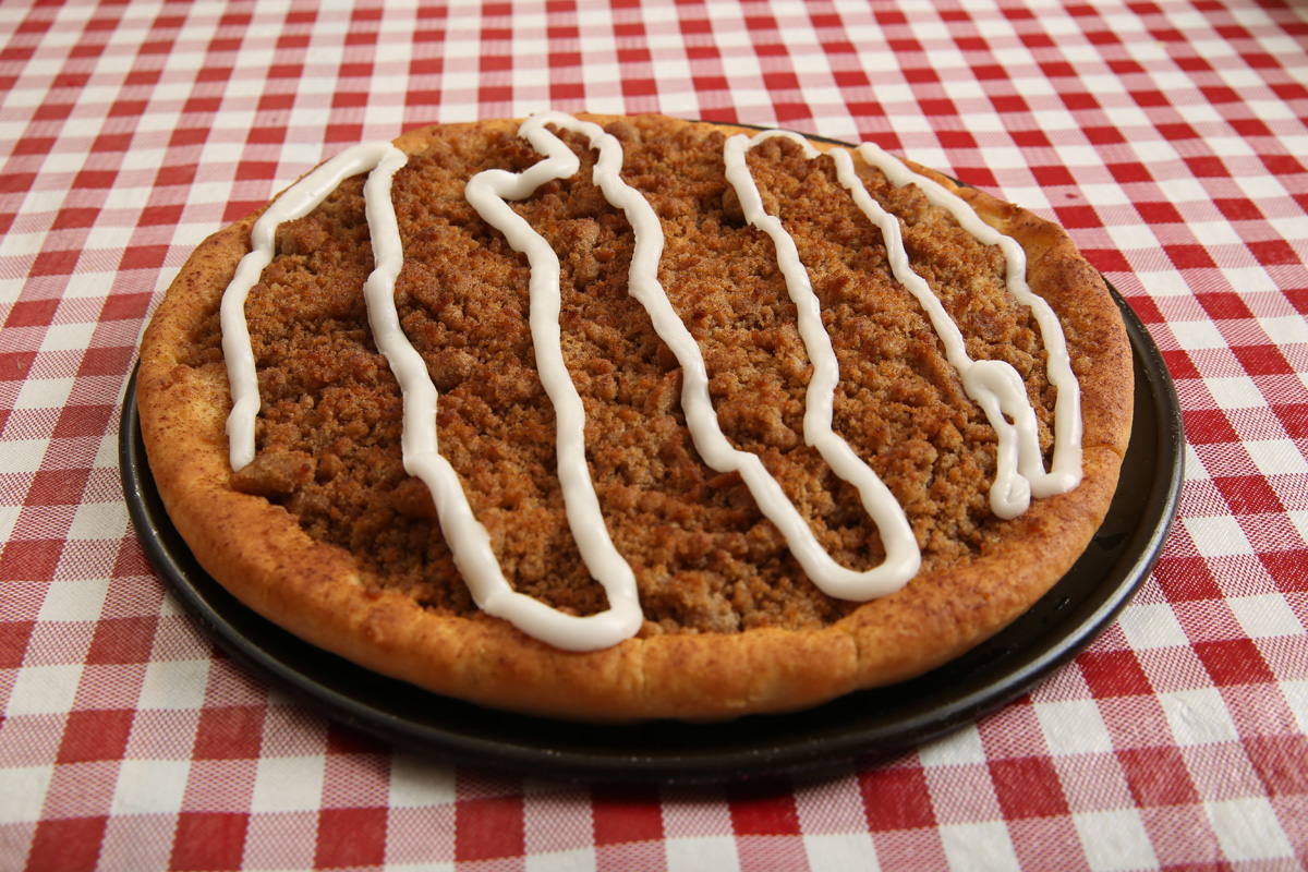 Dessert Pizza - Our delicious Sicilian crust with crumbled Cinnamon Streusel topping & Icing. Plenty to share!Serves 3-4 people. . . . . . $6.99