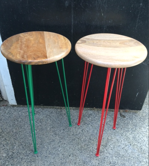 Tall stools or side tables. Green and Red.