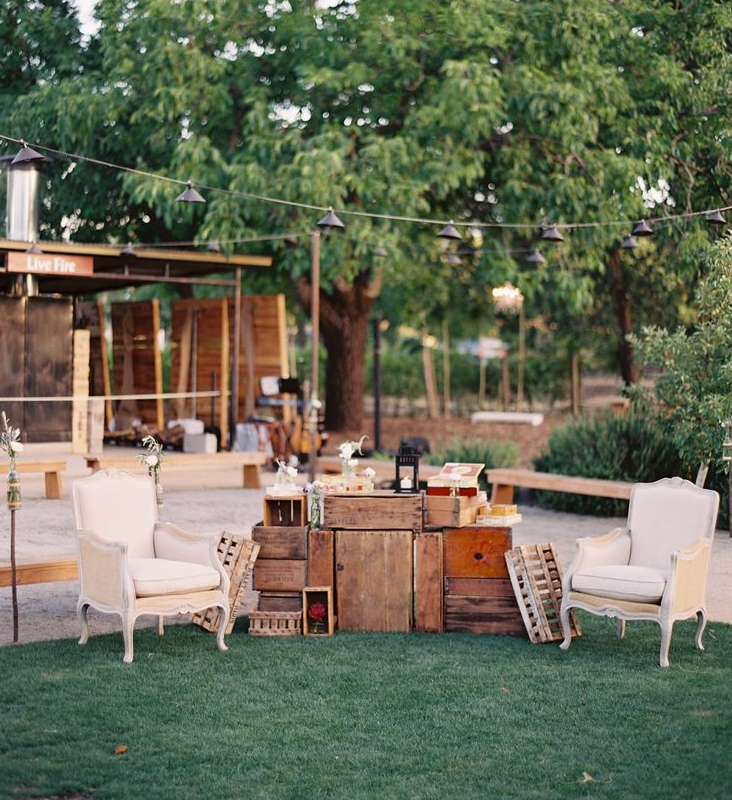Two upholstered chairs and a few rustic wooden crates create a great photo opportunity.