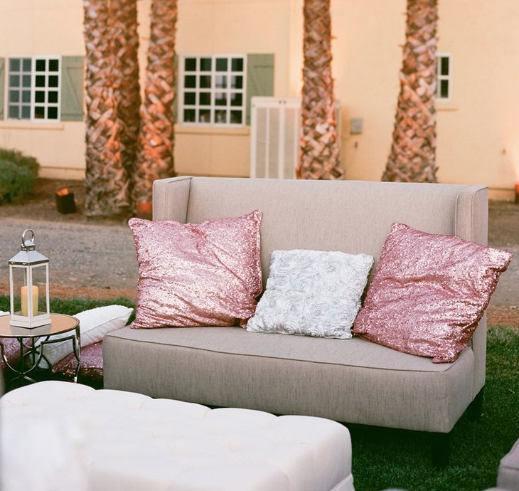 Toss some pillows on top a love seat (just like our  Grand !), a side table and a bench for a perfect mini-lounge.
