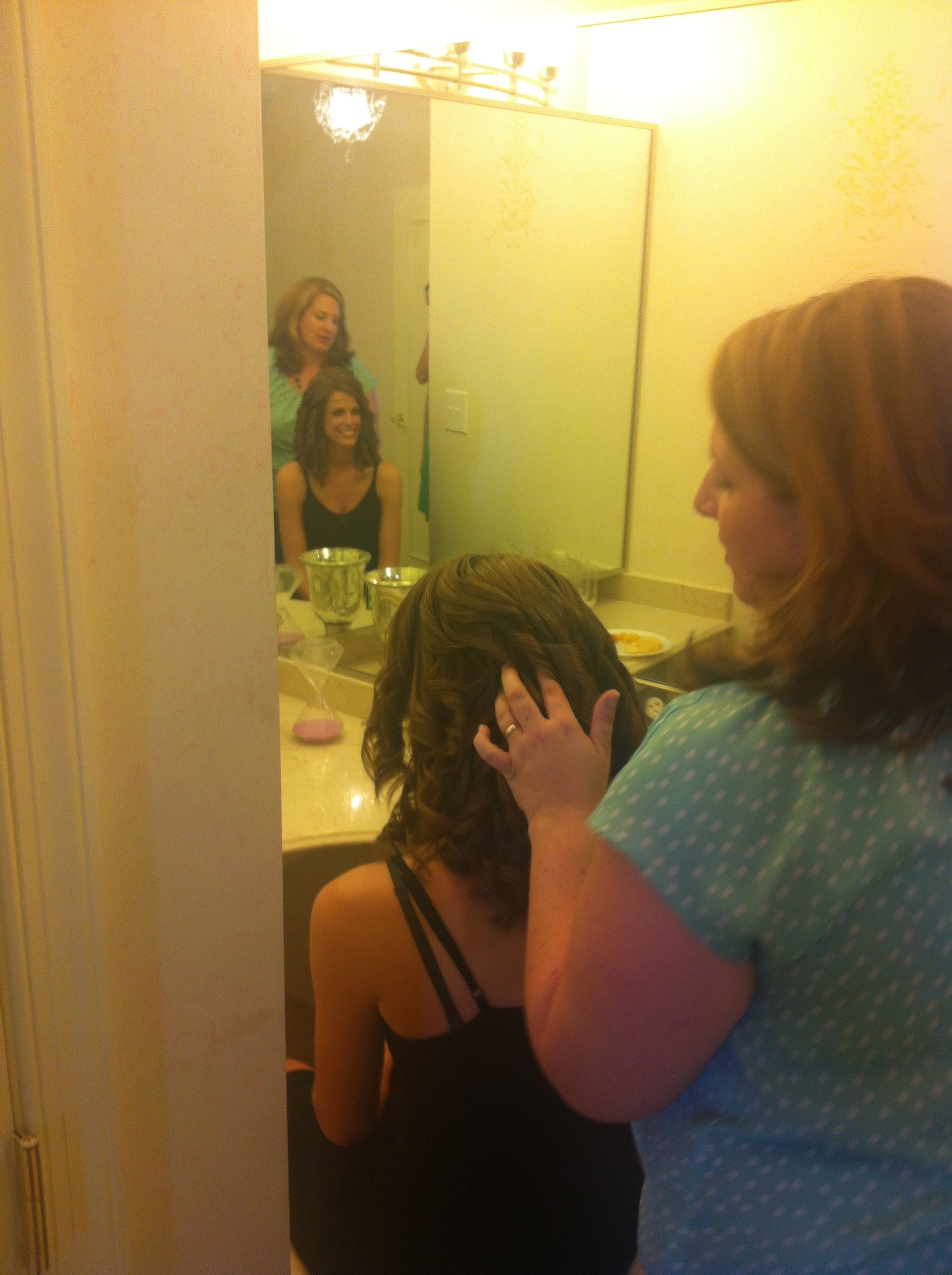 The bride getting her hair done!
