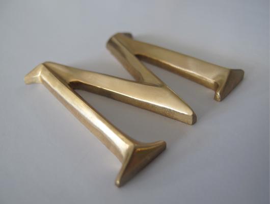metal letters & logos-metal letter-water jet cut-prismatic letter-bronze-masterwork plaques.jpg