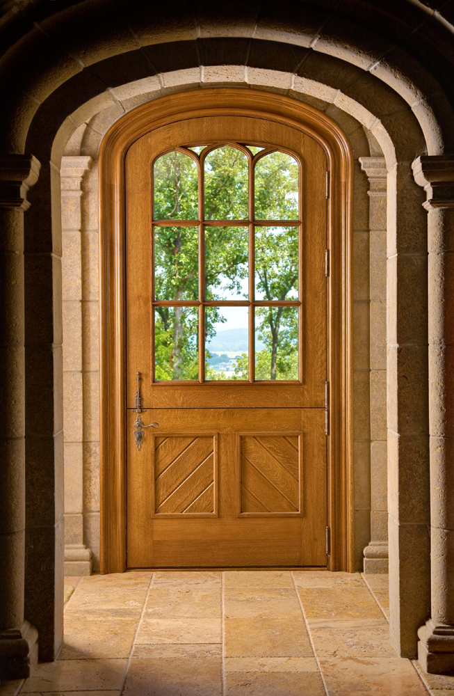 Oversized dutch door with tudor arch - true divided light glass design.