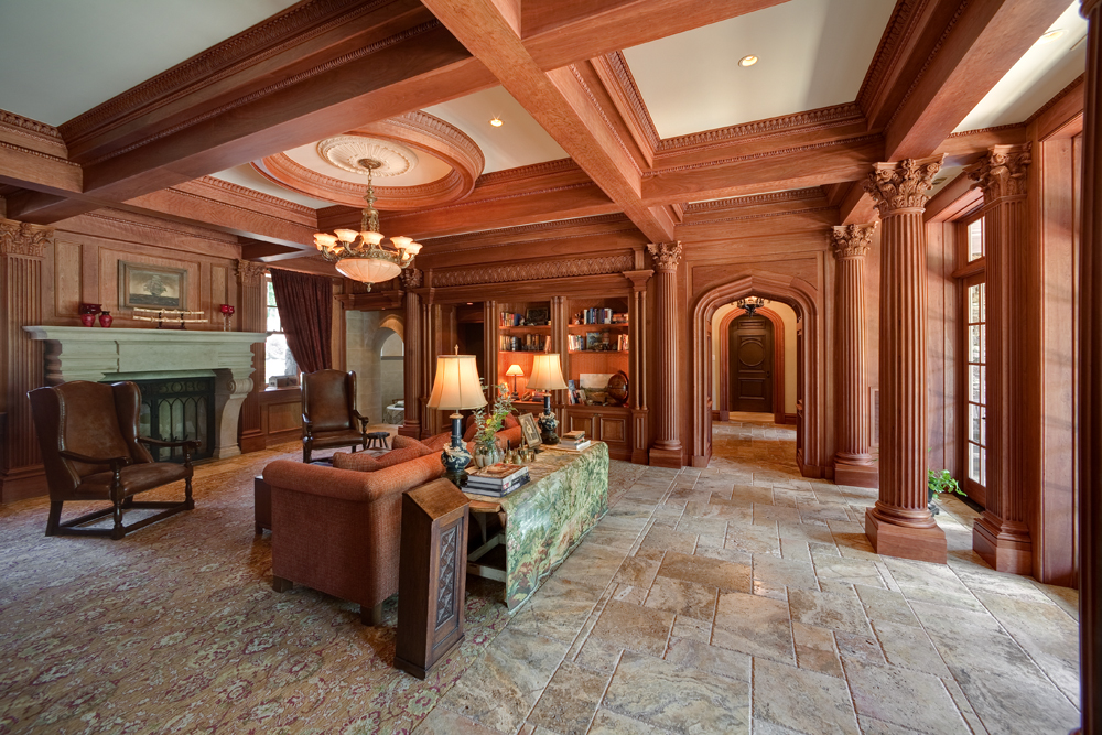 The Library.   A labor of love, with hand-carved and hand-rubbed moldings, deeply fluted columns, coffered ceilings, antique onyx lighting and high ceilings.