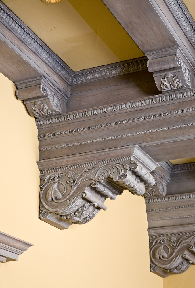 Custom handcarved corbels  feature spades, hearts, clubs and diamonds motifs.