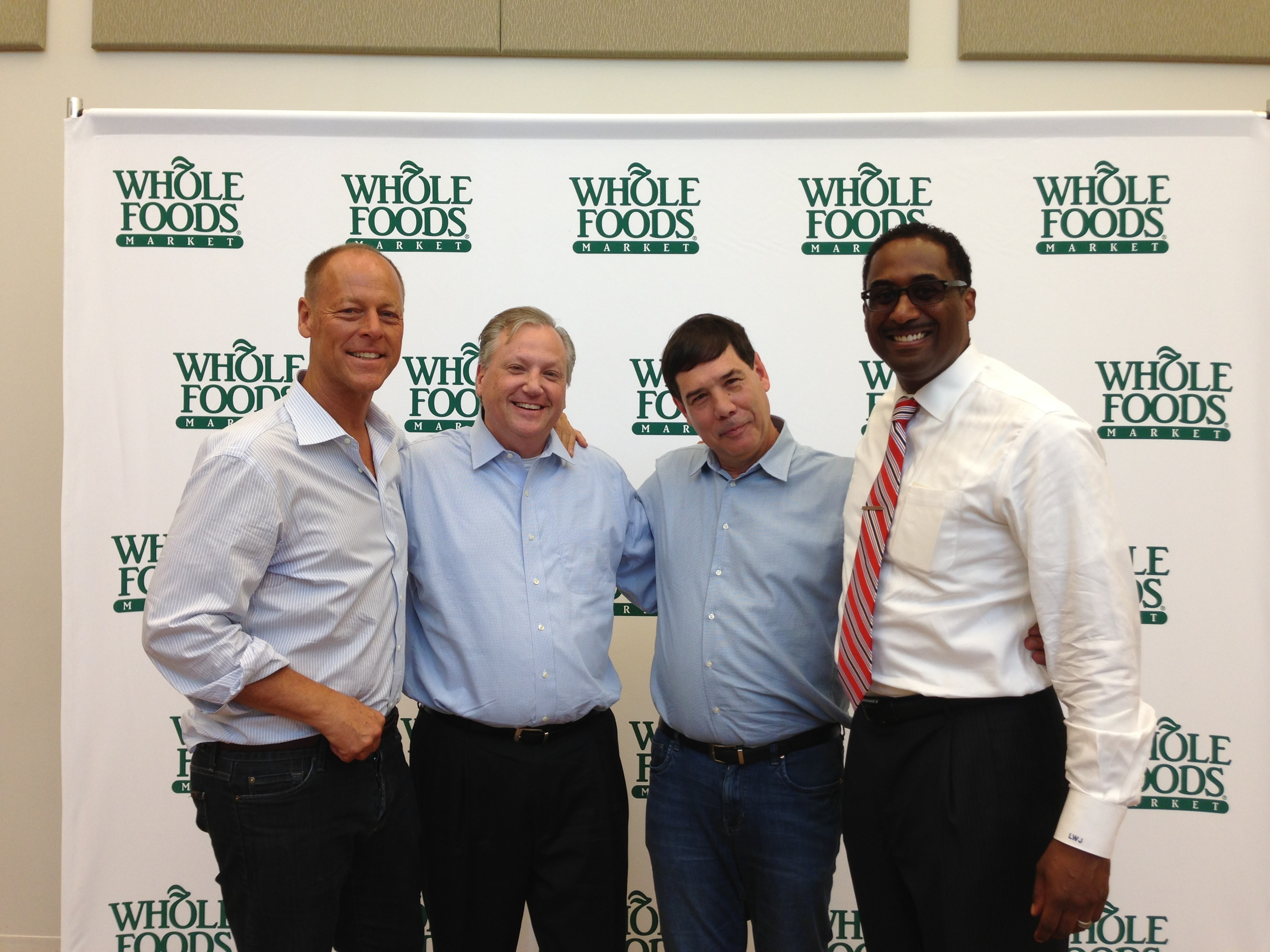 From left to right: Walter Robb (co-CEO, Whole Foods), Dave Doig (President, Chicago Neighborhood Initiatives), Michael Bashaw (Midwest Regional President, Whole Foods), and Leon Walker (Manager, DL3).