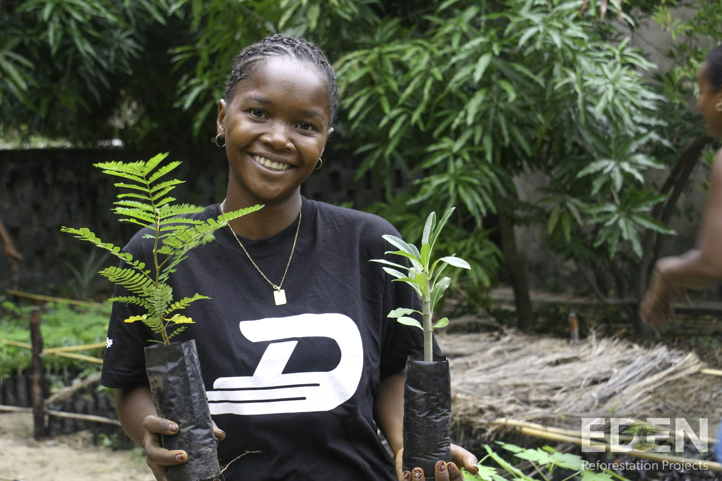 Madagascar_2013_Mamatiana holding seedlings.jpg