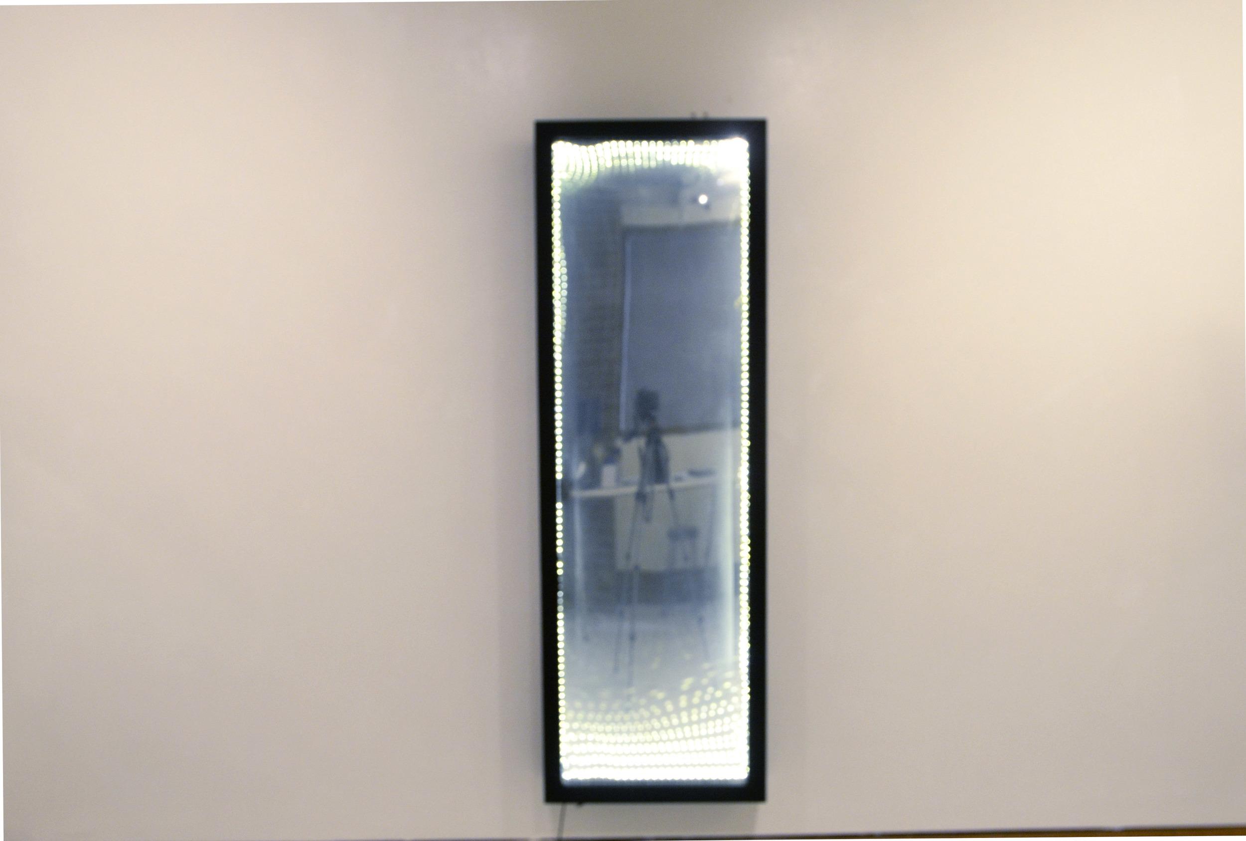 Infinity Mirror. Plexiglass, mirror panel, LED string-lights, wooden frame. 16x62.