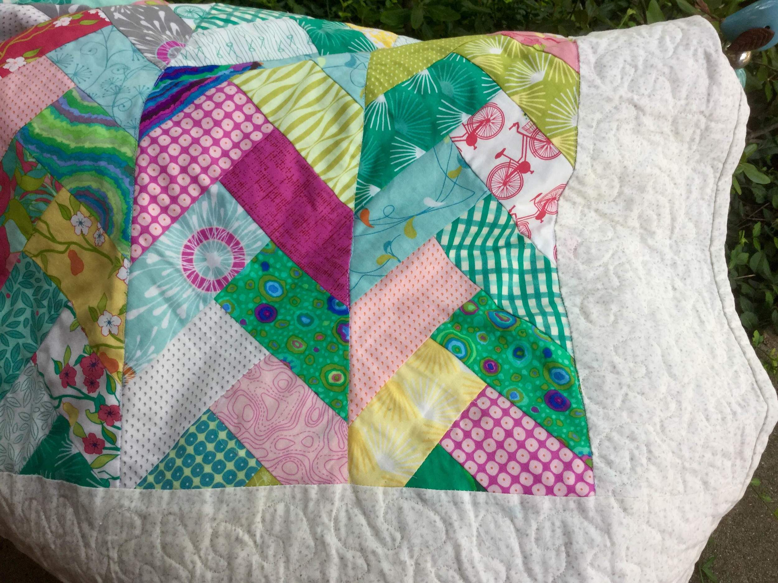 I used the walking foot to stitch in the ditch on the seams of the 8 braids. I free motioned the borders. This was how it was shown in the Pinterest picture.
