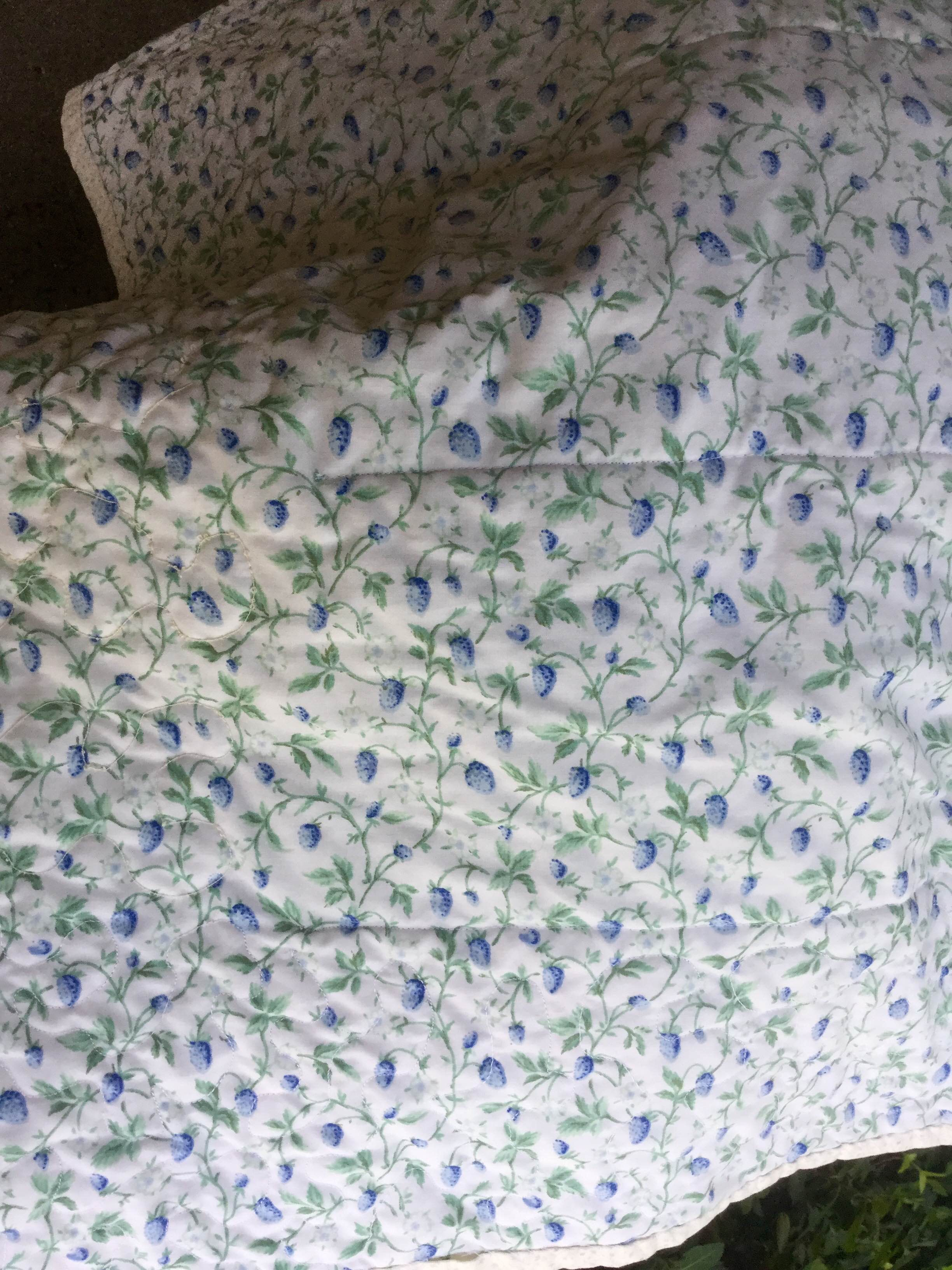 The back shows the straight line stitching and the stippling. I found a vintage sheet at an estate sale and used it as the back. It is silky soft and many might remember this sheet in their grandma's linen closet.