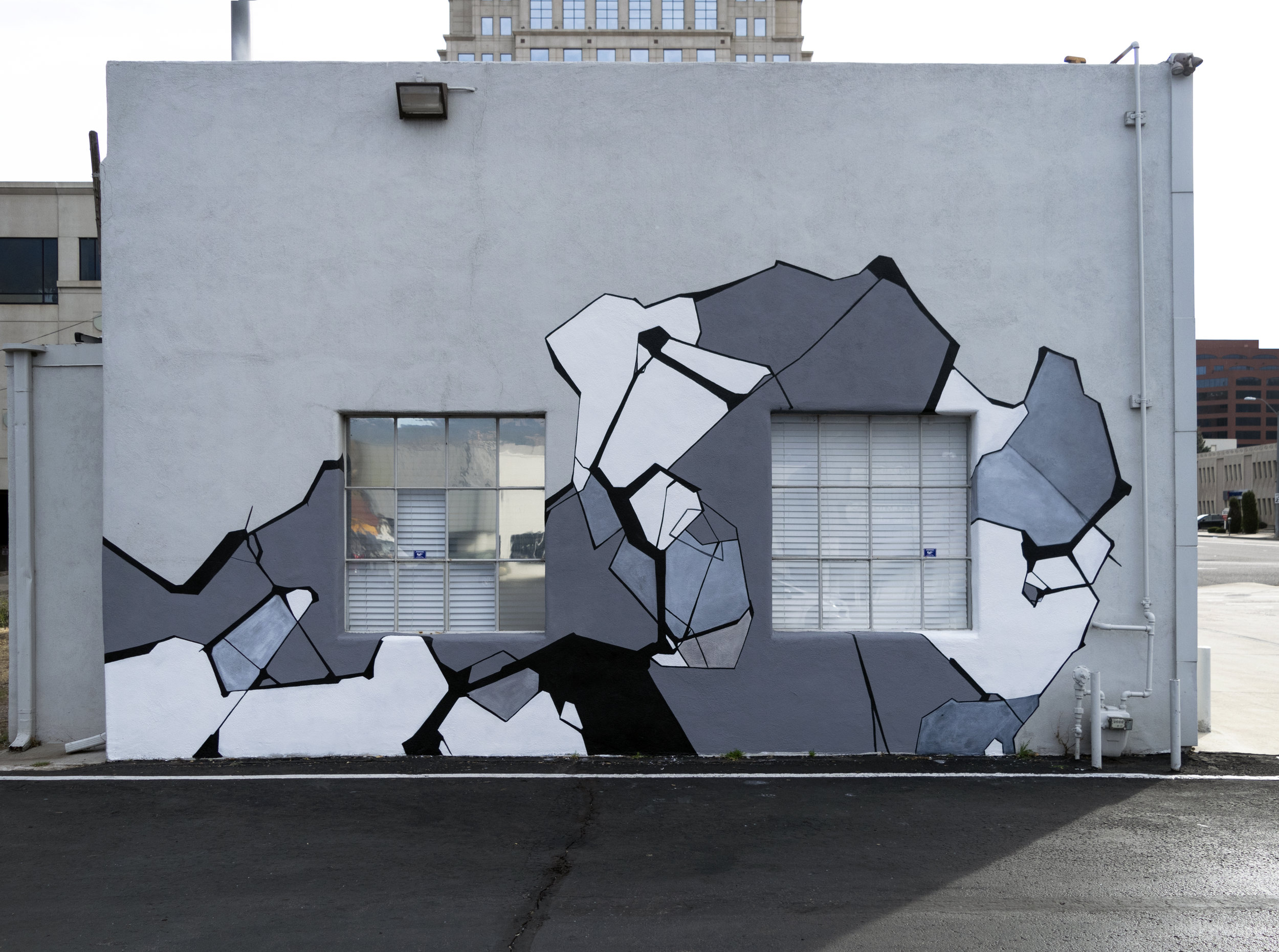 Transmutation |  102 W. CO. AVE. COS. CO. 80903 | October 2018 | House paint on exterior, west facing, wall.