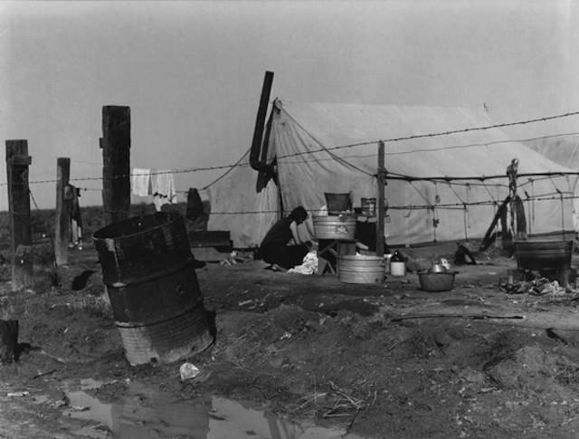 Dorothea Lange,  Woman Washing, Migrant Camp , 1938.
