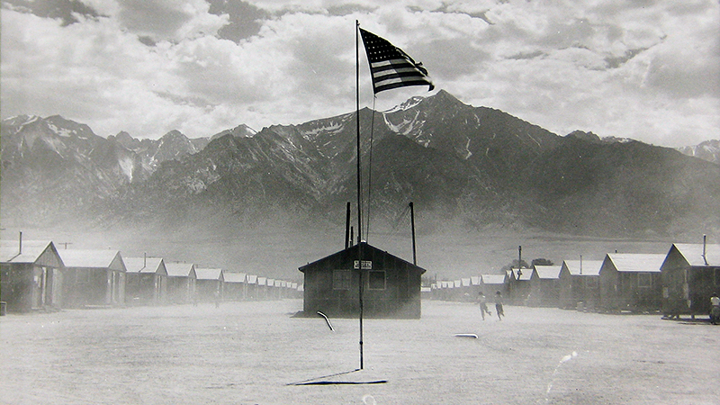 Dorothea Lange, 'Manzanar, California. Dust storm at this War Relocation Authority center where evacuees of Japanese ancestry are spending the duration, July 3, 1942.' (Courtesy of OMCA)