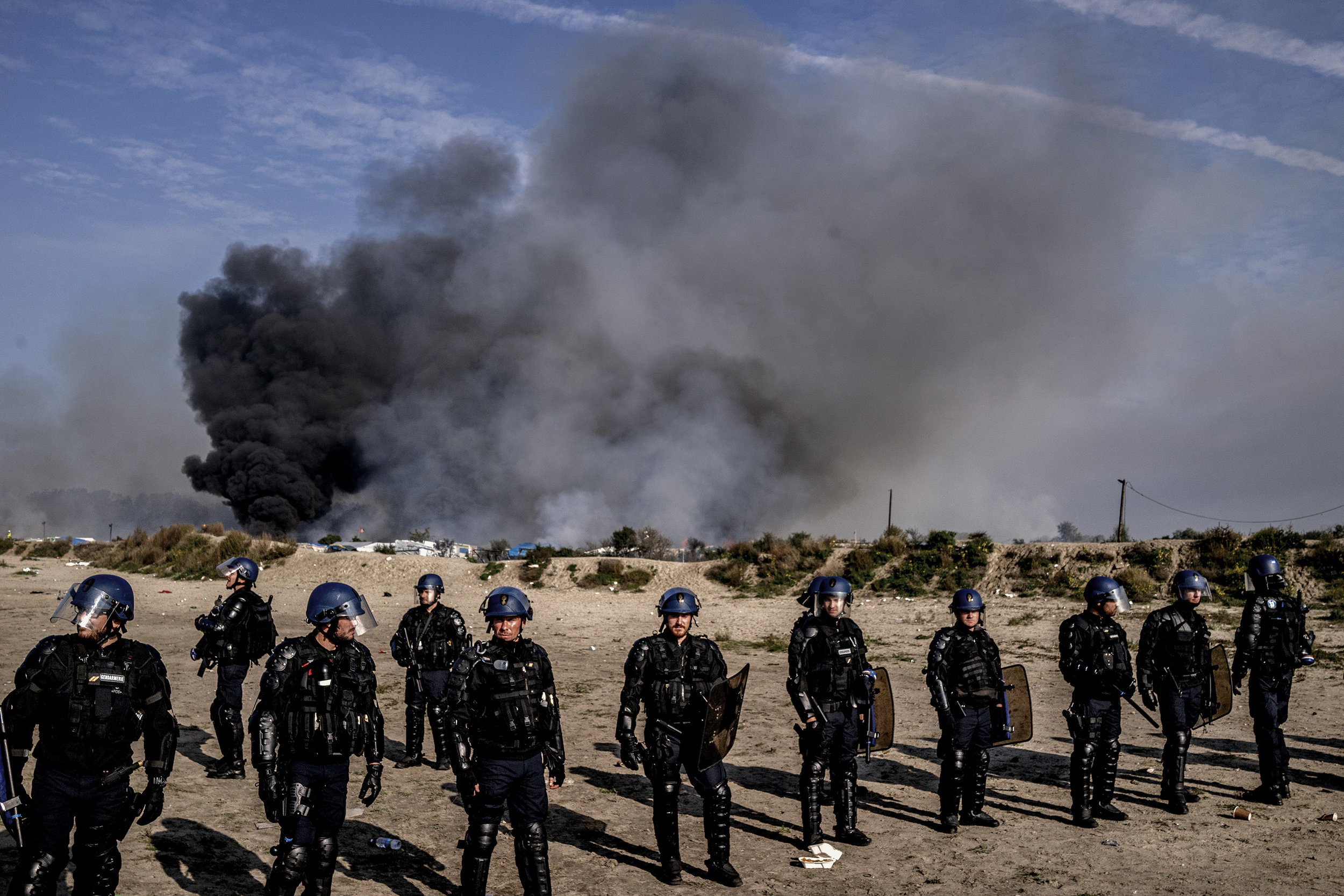 26th October 2016, The Jungle of Calais in France is in huge fire. French police cordon the entrance of the jungle of calais.