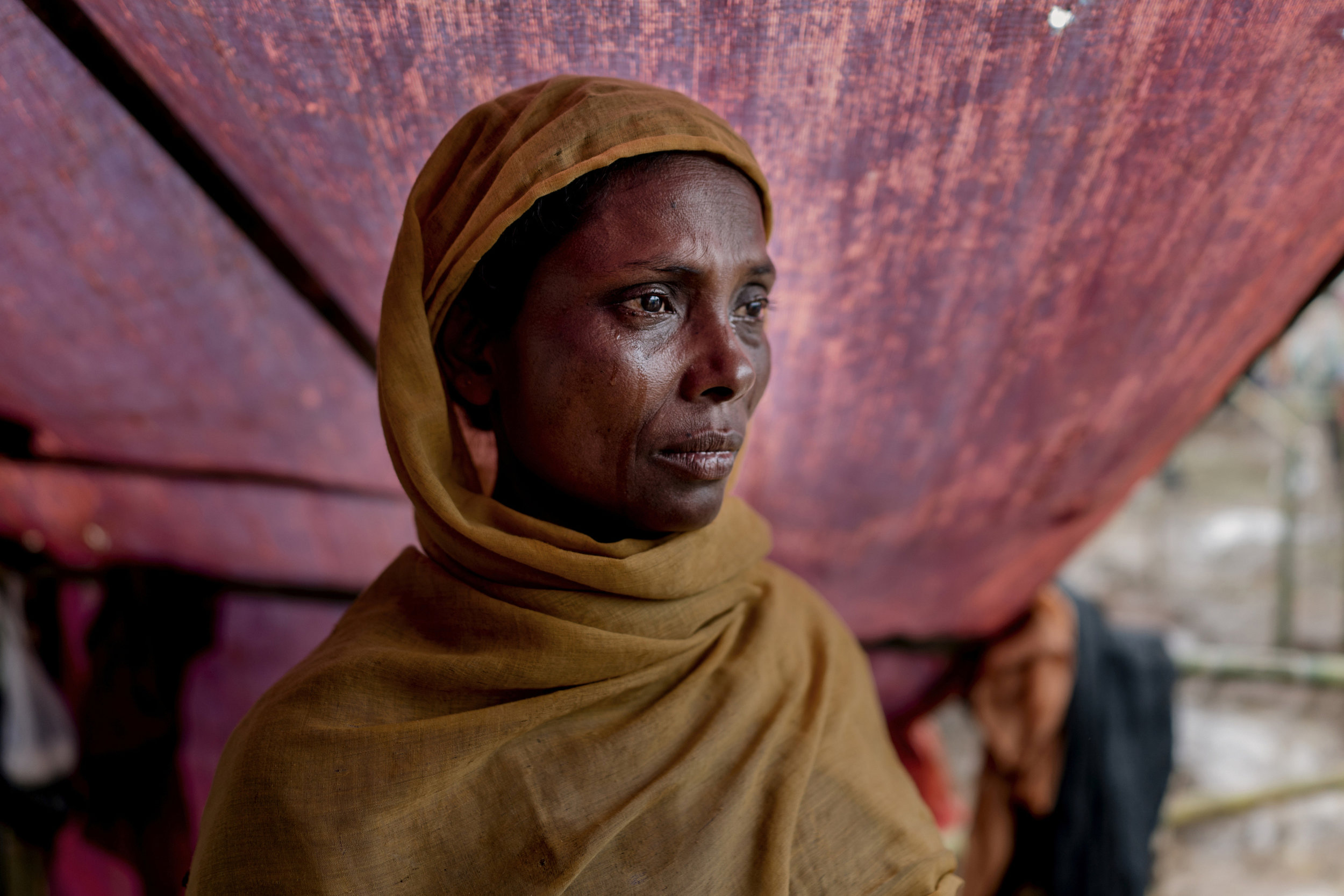 A Rohingya mother, her 5 years old only son was shot to death by Burmese military. They shot in his ear while Myanmar military was putting land mine 25 days ago. She walked with her husband Abdur Rahman to the Bangladesh border with her wife and 6 daughters for 7 days then entered to Palangkhali border, Bangladesh.
