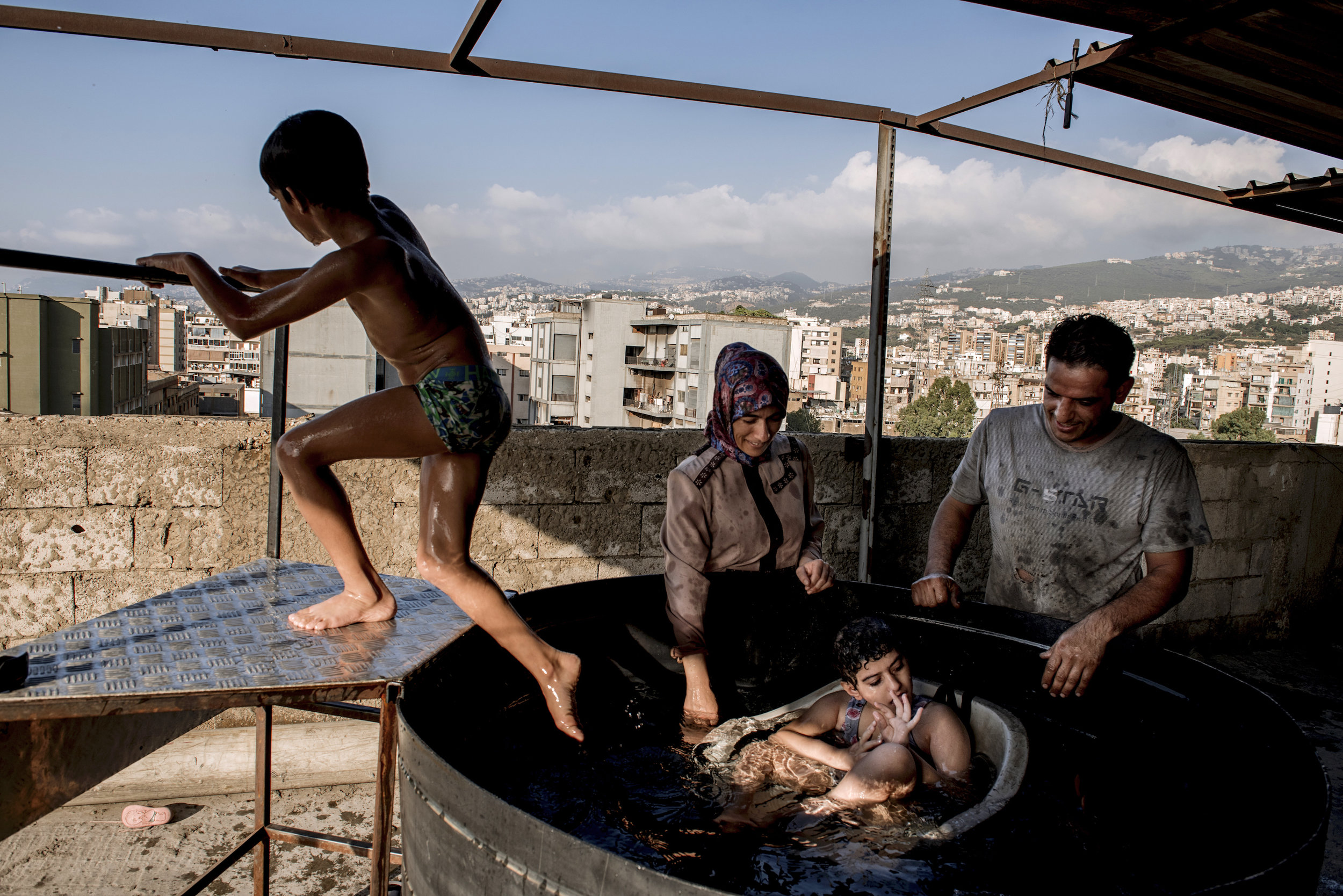 Mohamad  El Saho and Leila  El Saho give bath to their daughter Sendos.Sendos El Saho (12 years old). Sindos is a girl suffering from a severe degree of cerebral palsy and epilepsy and her younger brother Tamim who was also diagnosed with moderate cerebral palsy (lower degree than Sindos).