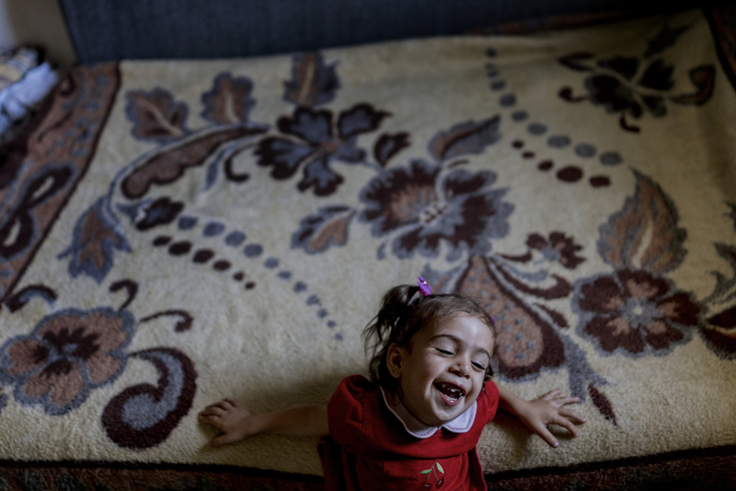 Liliane (2 years old)  suffer from Metabolic Disease which is hereditary and some of the symptoms the kids suffer are liver dysfunction, osteoporosis, mental retardation, heart disease, pulmonary disease. Her father Sohayb Mohamad a dayworker came to Lebanon from Syria with 3 children and his wife.
