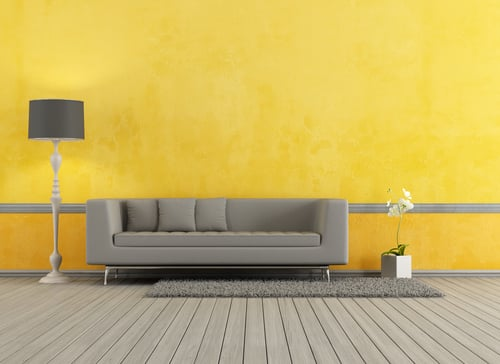 yellow room with couch and lamp