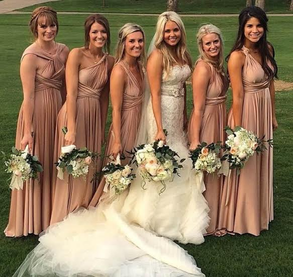 Rachel's bridesmaids wore twobirds bridesmaid wrap dresses. One dress that ties multiple ways. We love this dress not only because it's so pretty but it's also really comfortable!