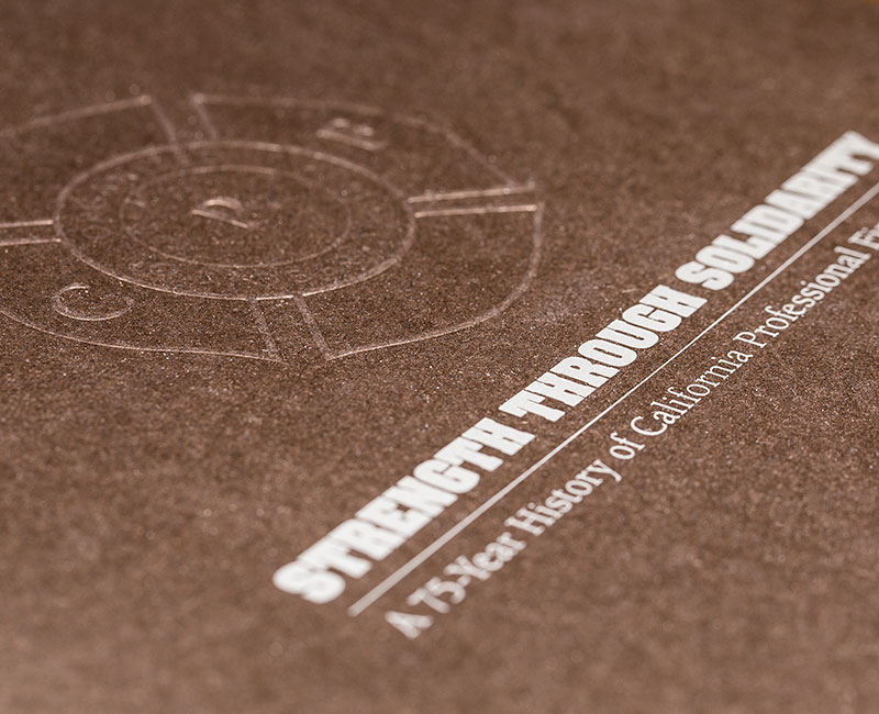 Blind emboss and foil on cover