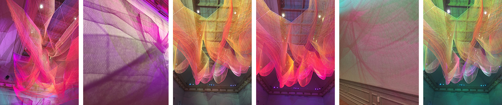 "Janet Echelman's Suspended Woven sculpture, ""1.8"" is in a gallery 100 feet long. It was inspired by the Tsunami in Japan in 2011. changing lights, and the shadows cast on the gallery walls, make it completely mesmerizing."