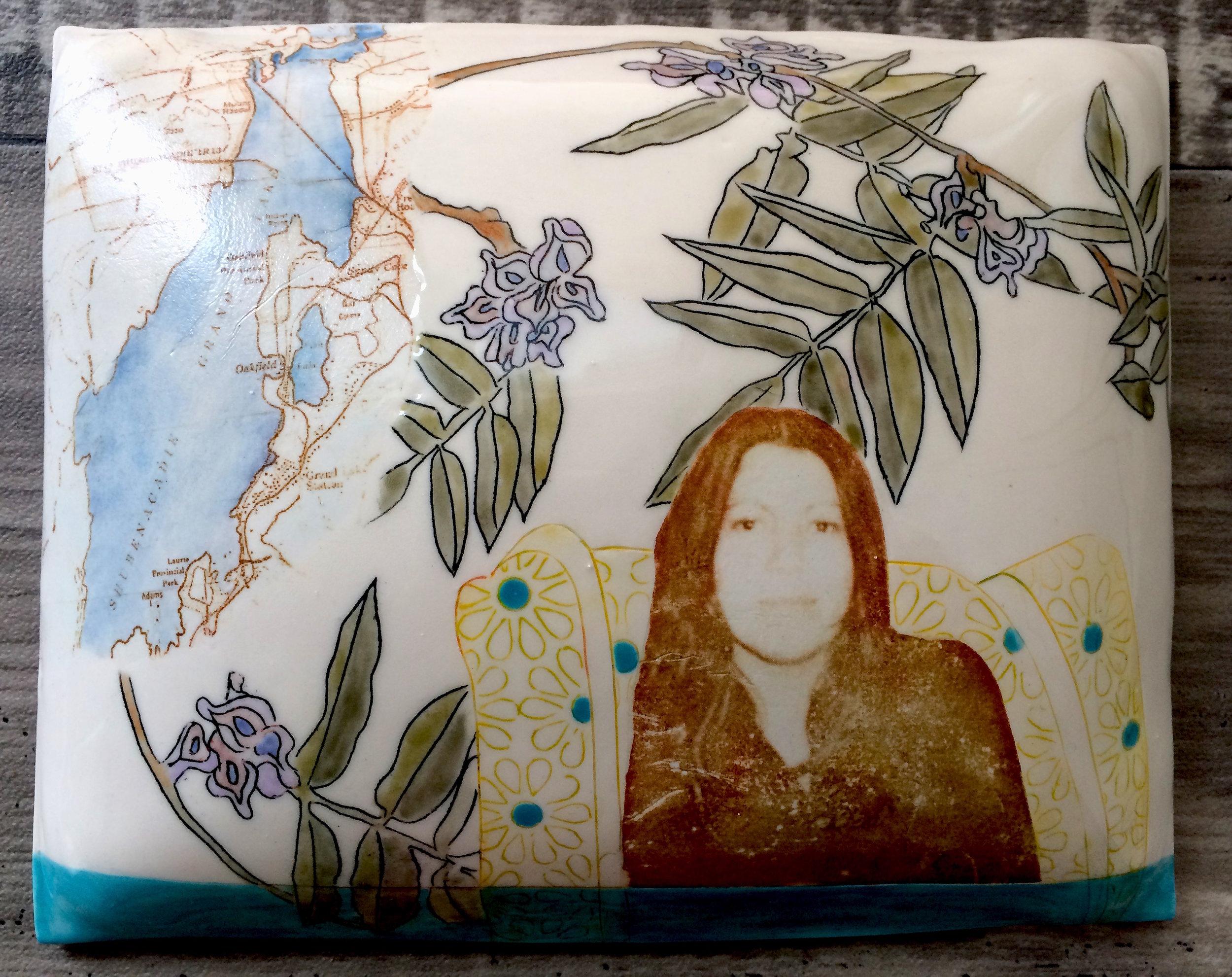 "Marney McDiarmid,  Anna Mae Aquash , porcelain pillow, 8"" x 10"" (installation detail of Big Dreams)"