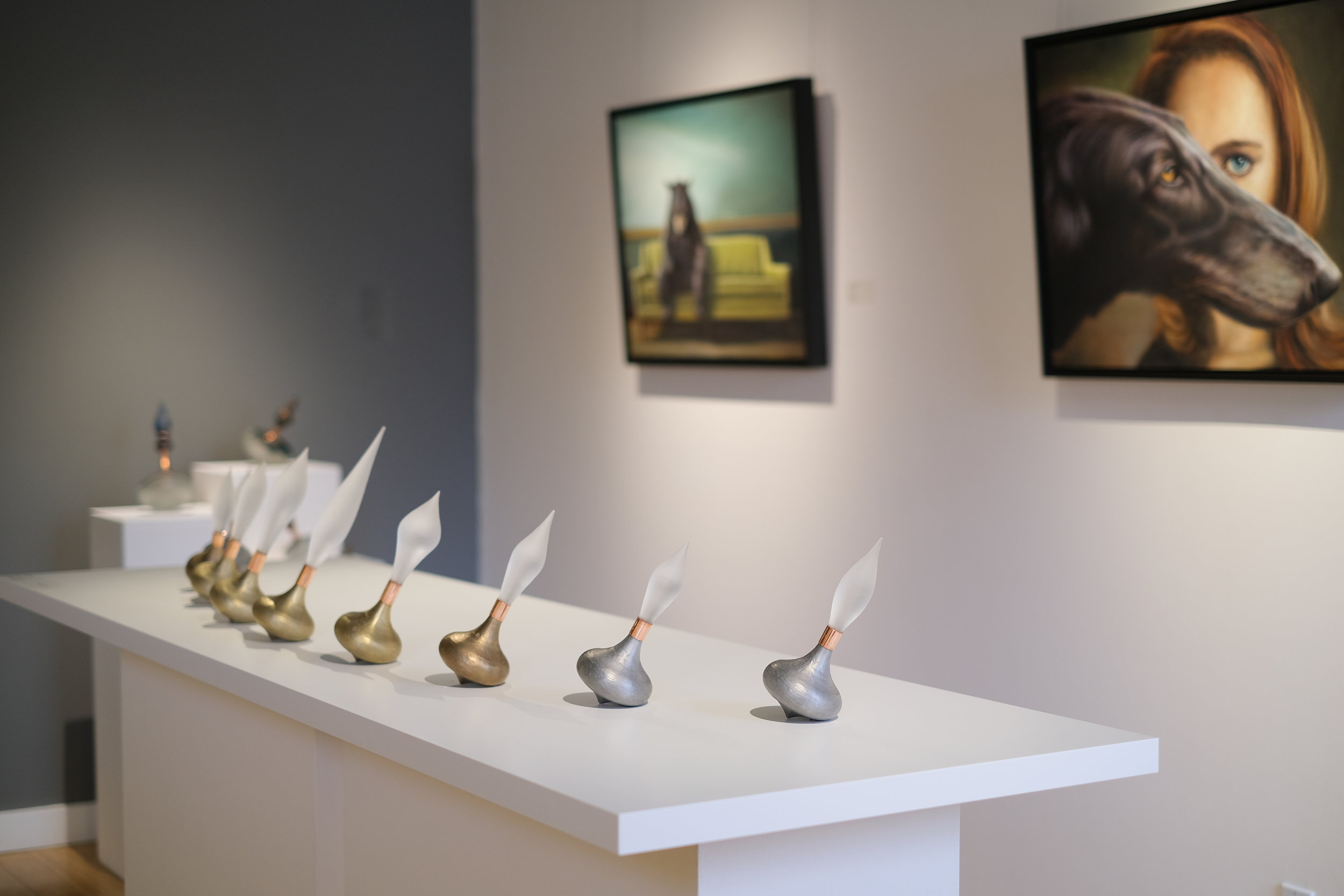 Foreground: Silvia Taylor,  Ogee Calamus  installation, glass and copper with aluminum, brass, and bronze