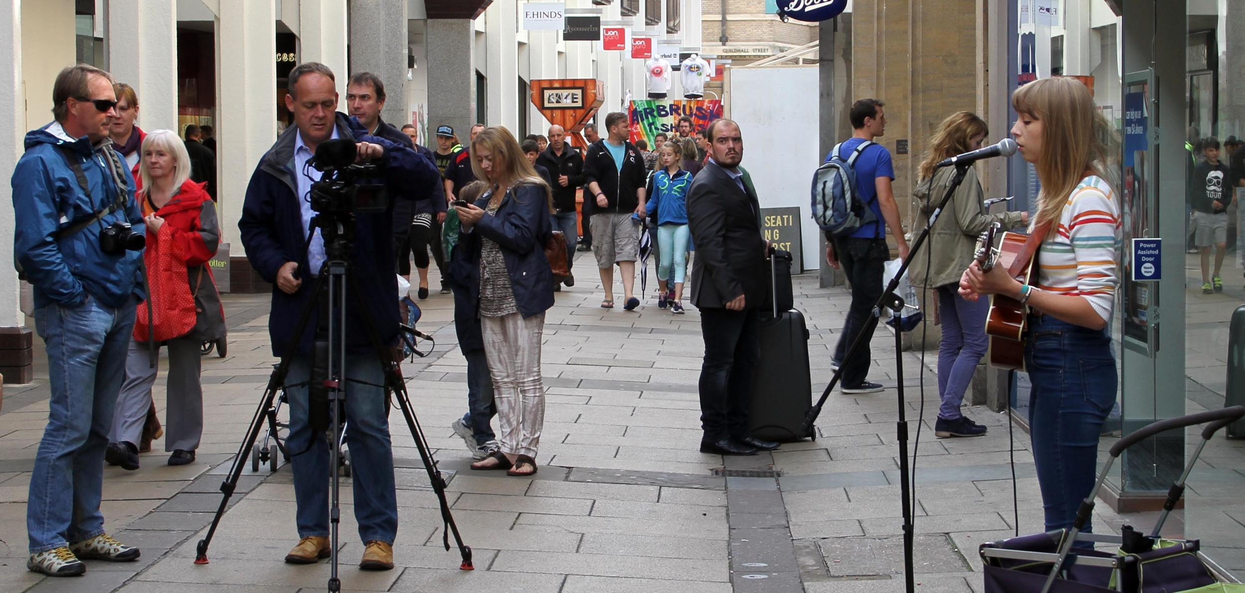 Rachel Clark being filmed by the ITV Anglia News film crew in Petty Cury, Cambridge