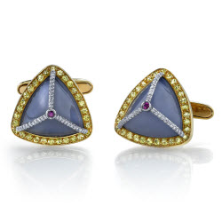 2009 Spectrum - 1st Place Men's Wear    Ricardo Basta Fine Jewelry & E. Eichberg Jewelers   18K yellow gold and platinum cufflinks featuring lavender Chalcedony cabochons (14.70 ctw), round yellow Sapphires (1.57 ctw), round Diamonds (0.17 ctw) and round Rubies (0.08 ctw).