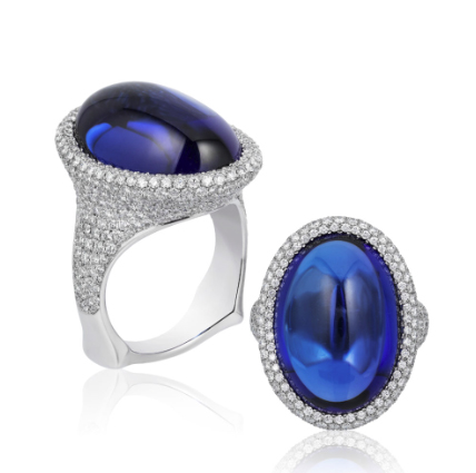"2018 Spectrum - 2nd Place Bridal Wear    Ricardo Basta Fine Jewelry & E. Eichberg Jewelers   Platinum ""Take the Plunge"" ring featuring a 21.86 ct. oval Tanzanite cabochon accented with Diamonds (2.13 ctw.)."