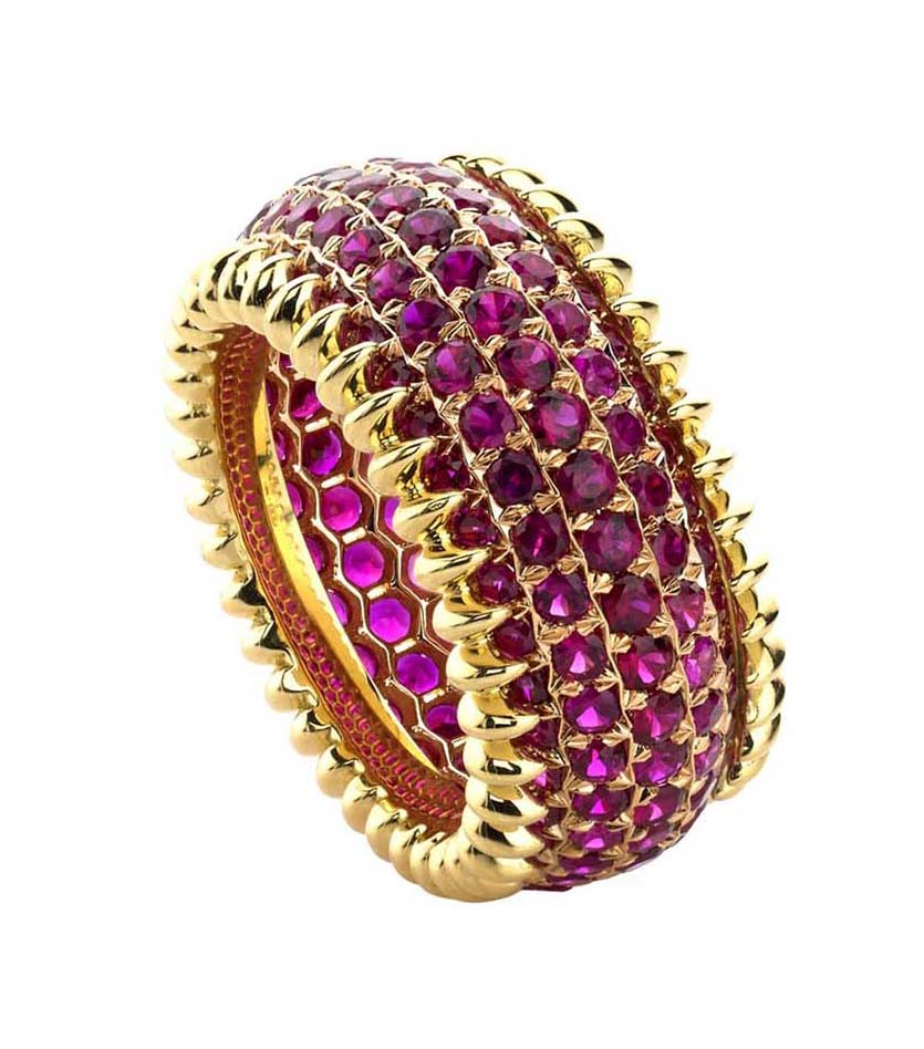 2014 Spectrum - Manufacturing Honors Business/Day Wear    Ricardo Basta Fine Jewelry & E. Eichberg Jewelers   18K rose and yellow gold ring with honeycomb ajour pierced out detail featuringround brilliant Rubies (3.97 ctw) in a star-point setting.